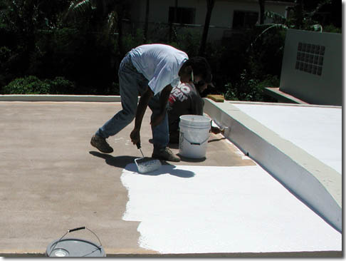 Roofer applying roof coating in Okahumpka FL