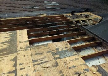 Storm damage to roof in Oxford by P.J. Roofing, Inc