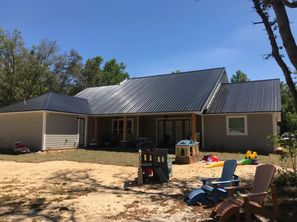 Roof Installation with a Black 26 Gauge Rib Metal Which has an Energy-Efficient Rating in Crystal River, FL (2)