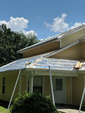 Roof with 26 Gauge Rib Panel Galvalume and Color Go Over the Existing Roof with One by Fours and Foil Insulation in Floral City (5)