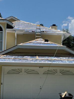 Roof with 26 Gauge Rib Panel Galvalume and Color Go Over the Existing Roof with One by Fours and Foil Insulation in Floral City (6)