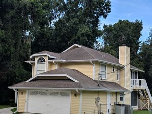 Roof with 26 Gauge Rib Panel Galvalume and Color Go Over the Existing Roof with One by Fours and Foil Insulation in Floral City (9)